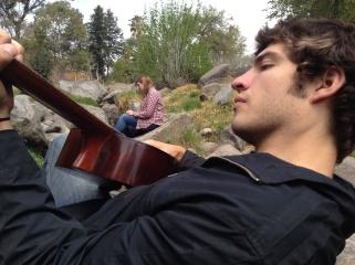 I'm teaching Jake some guitar.
